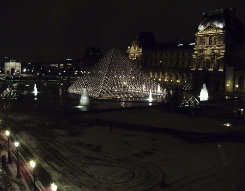 Cold, snowy night- cour Napoleon, Pyramid, and Arc de Triomphe du Carrousel viewed from inside Le Louvre, Paris © 2009 Lanora S. Mueller