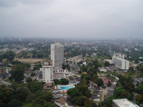 View of Kinshasa, mostly Gombe, with the commercial centre in the distant left, and the old township in the distance in the centre. Taken from the Centre Commercial International Congolais (CCIC). Image from commons.wikimedia.org